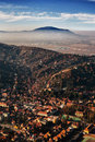 Brasov city seen from above with smog and mountain in background Royalty Free Stock Photos