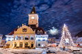 Brasov council square in christmas night romania and xmas tre historical medieval old city center of days Royalty Free Stock Images