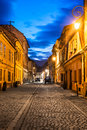 Brasov romania transylvania night scene of medieval paved street in downtown of the city saxon landmark in Stock Photo