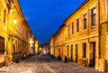 Brasov romania transylvania night scene of medieval paved street in downtown of the city saxon landmark in Royalty Free Stock Image