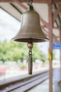 Brass bell in train station Royalty Free Stock Photography