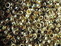 Brass circular vintage eyelets used in fashion and leather work Royalty Free Stock Photo