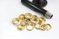 Brass eyelets and eyelet tool Royalty Free Stock Photo