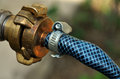 Brass hose coupling detailed view of a Royalty Free Stock Photos
