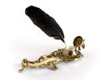 Brass inkwell with feather Royalty Free Stock Photo
