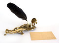 Brass inkwell with feather and postcard Royalty Free Stock Photo
