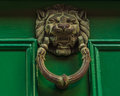 Brass knocker in the shape of lion head Royalty Free Stock Photo