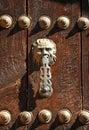Brass knocker on wooden door of oak, Ronda, Malaga province, Spain