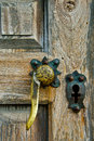 Brass latch and cross keyhole wooden mission door with shaped Stock Image