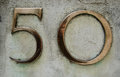 Brass number fifty figures for a outside an office block in central london Stock Images
