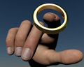 Brass ring someone grabbing the Royalty Free Stock Images