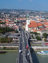 Bratislava as seen from snp bridge summer view portraying wider center of town with road and tower of the st martin s cathedral Stock Photo