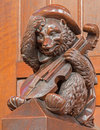 Bratislava - Bear with the violin sculpture from bench in presbytery in st. Matins cathedral Stock Images