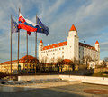 Bratislava castle with flags Stock Photos