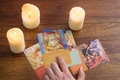 Bratislava, Slovakia, February 2017: illustrative and editorial tarot cards and burning candle on wooden table Royalty Free Stock Photo