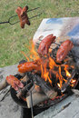 Bratwurst preparing on the fire Royalty Free Stock Photo