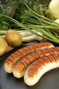 Bratwurst, sausage and some fresh vegetables Royalty Free Stock Photo