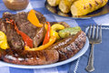 Bratwurst and steak picnic dinner Royalty Free Stock Photo