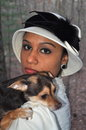 Brave lady an elegant young woman is holding a little chihuahua in her shoulder Royalty Free Stock Photos