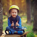 Brave little boy having fun at adventure park and giving double thumbs up Royalty Free Stock Photography