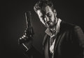 Brave man with dangerous weapon cool holding a on dark background Stock Image