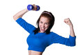 Brawny girl with dumbbell pretty happy sporty young woman model in blue top lifting up smiling cheerfully laughing loudly looking Royalty Free Stock Photography