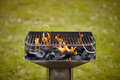A brazier with charcoal and flame in it Royalty Free Stock Photo