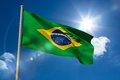Brazil national flag on flagpole blue sky background Royalty Free Stock Photo