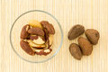 Brazil nuts in glass bowl and some nut in the shell Royalty Free Stock Photo