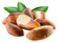Brazil nuts with leafs on white background Royalty Free Stock Photography