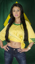 Brazil soccer football fan wearing green and yellow top beautiful happy smiling national flag Royalty Free Stock Photos