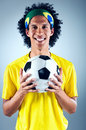 Brazil soccer man portrait of brazilian football player with ball and national kit ready for the world cup Stock Photos