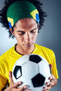 Brazil soccer man portrait of brazilian football player with ball and national kit ready for the world cup Royalty Free Stock Photos