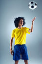 Brazil soccer man portrait of brazilian football player with ball and national kit ready for the world cup Royalty Free Stock Photo