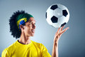 Brazil soccer man portrait of brazilian football player with ball and national kit ready for the world cup Stock Photo
