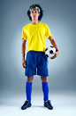 Brazil soccer man portrait of brazilian football player with ball and national kit ready for the world cup Royalty Free Stock Photography