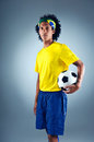 Brazil soccer man portrait of brazilian football player with ball and national kit ready for the world cup Stock Image