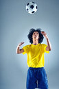 Brazil soccer man portrait of brazilian football player with ball and national kit ready for the world cup Royalty Free Stock Image