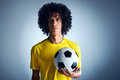 Brazil soccer man portrait of brazilian football player with ball and national kit ready for the world cup Stock Images