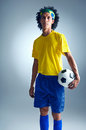 Brazil soccer man portrait of brazilian football player with ball and national kit ready for the world cup Royalty Free Stock Images