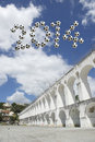 Brazil soccer message arcos da lapa arches rio de janeiro in football balls in the sky above Royalty Free Stock Image