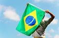 Brazil supporter holding flag a Stock Photos