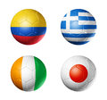Brazil world cup group c flags on soccer ball d balls with teams football isolated white Stock Image