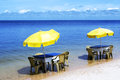 Brazilian beach tables and umbrella in a Royalty Free Stock Photography