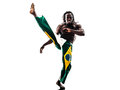 Brazilian black man dancer dancing capoeira silhouette one on white background Stock Images