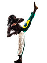 Brazilian black man dancer dancing capoiera one on white background Royalty Free Stock Images