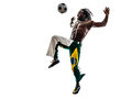 Brazilian black man soccer player juggling football silhouette one on white background Stock Photos
