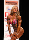 Brazilian bombshell juliana malacarne dazzles her performance routine as displays superb form which carried her to victory ifbb Royalty Free Stock Photo