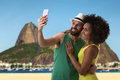Brazilian couple taking a selfie photo in rio de janeiro brazil Stock Images