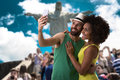 Brazilian couple taking a selfie photo in rio de janeiro brazil Royalty Free Stock Photo